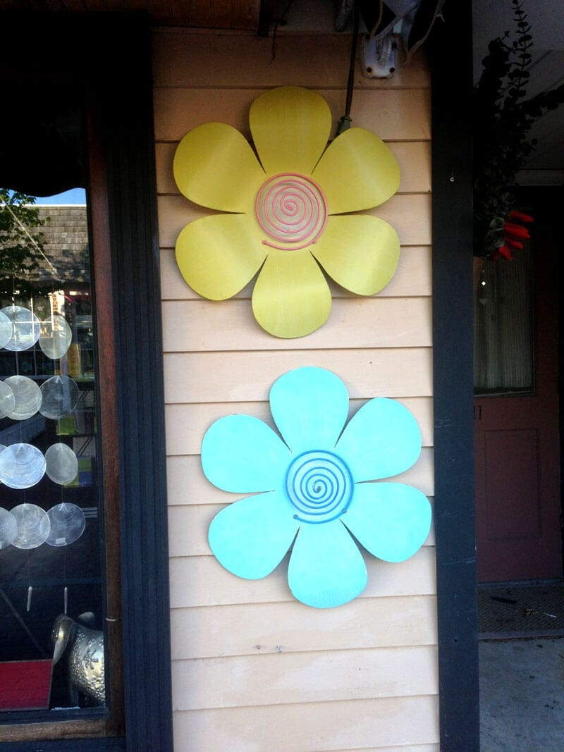 Tin Flowers hanging on wooden wall