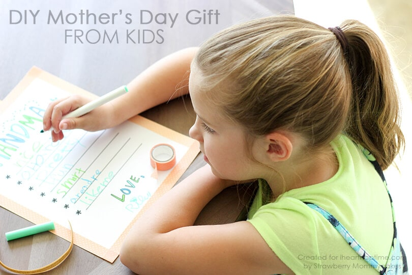 girl drawing on mother's day gift