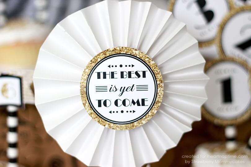 Black and Gold New Year Cupcake Toppers - free printable perfect for sparkling up your New Year's festivities! Perfect for topping cake or cupcakes, in timeless colors!