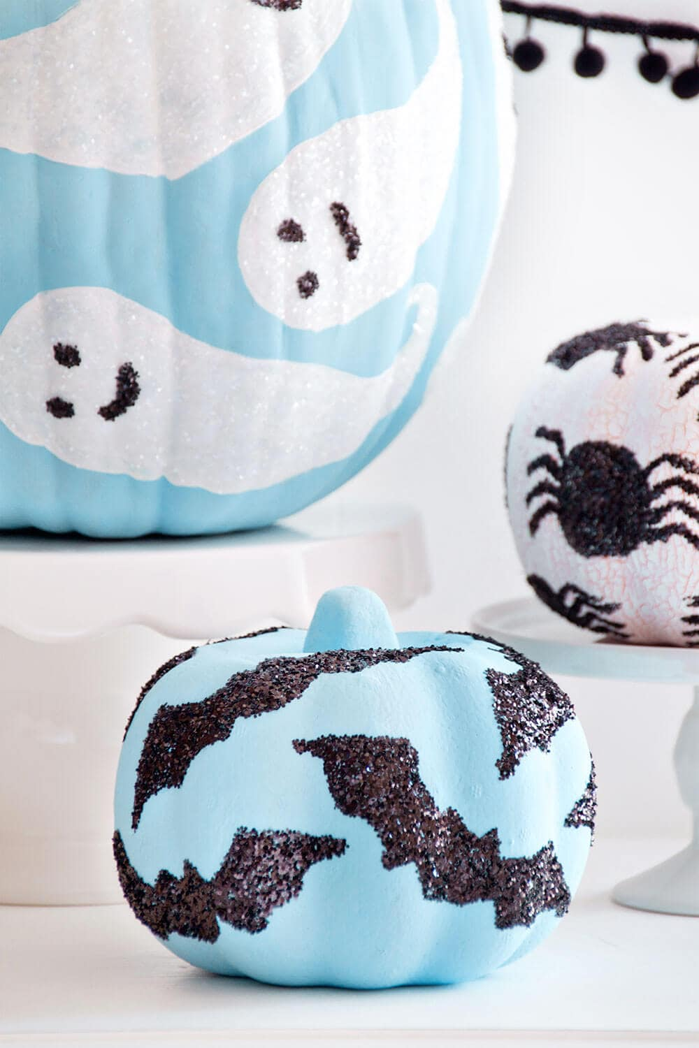 blue and white glitter decorated pumpkins