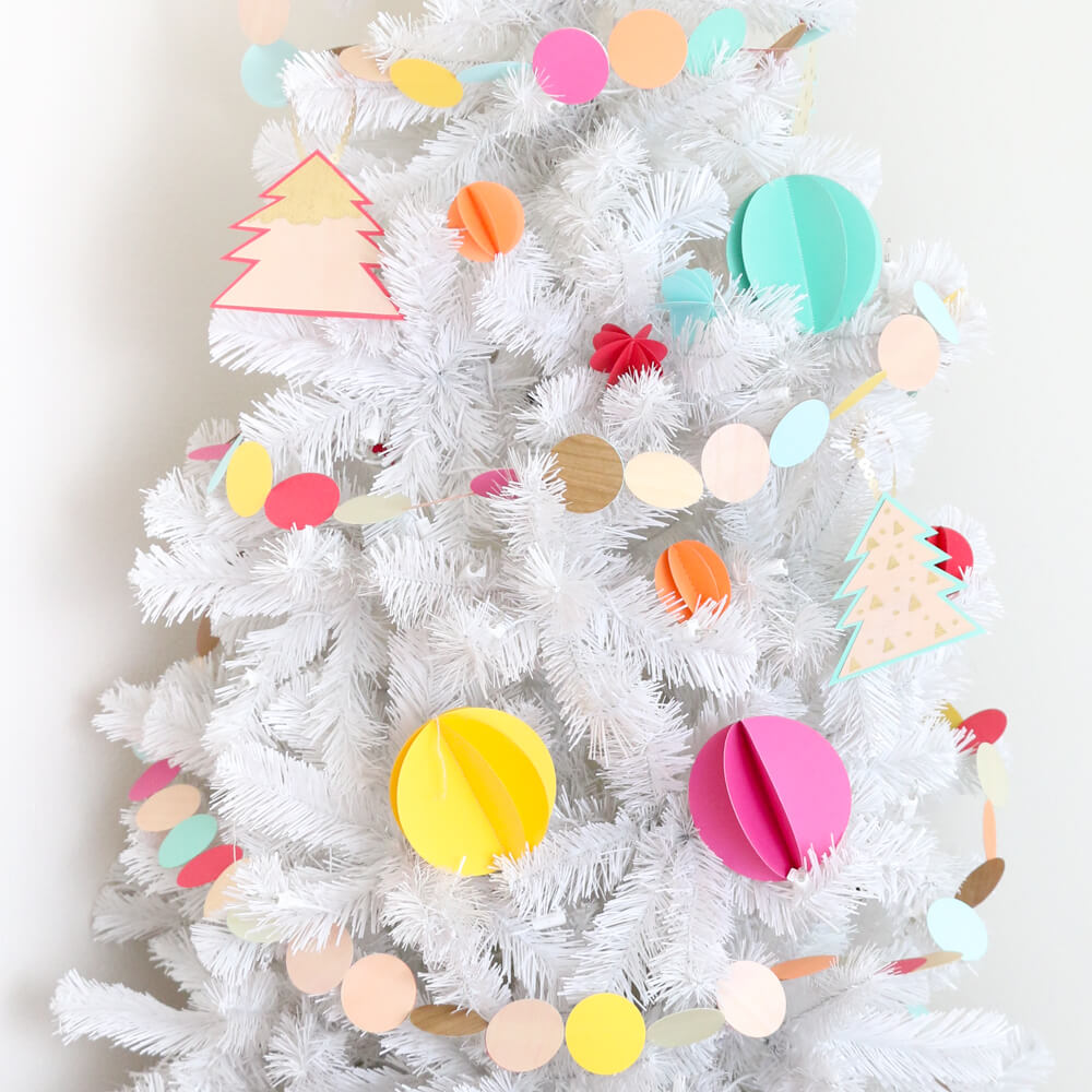 Colorful 3D Sewn Paper Ornaments... a simple and inexpensive way to decorate your Christmas tree this year!