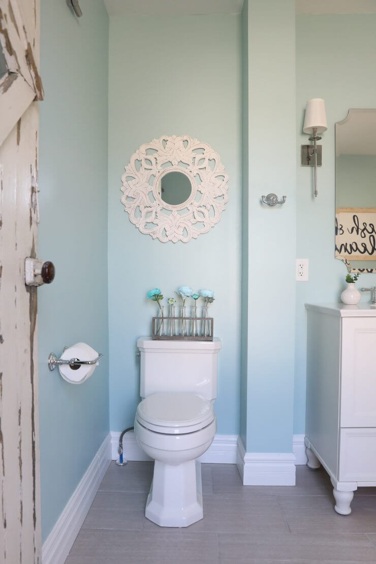 Fixer Upper Bathroom Before and Afters... fixer upper style bathroom makeover with clawfoot tub, watery paint color and sliding barn door.