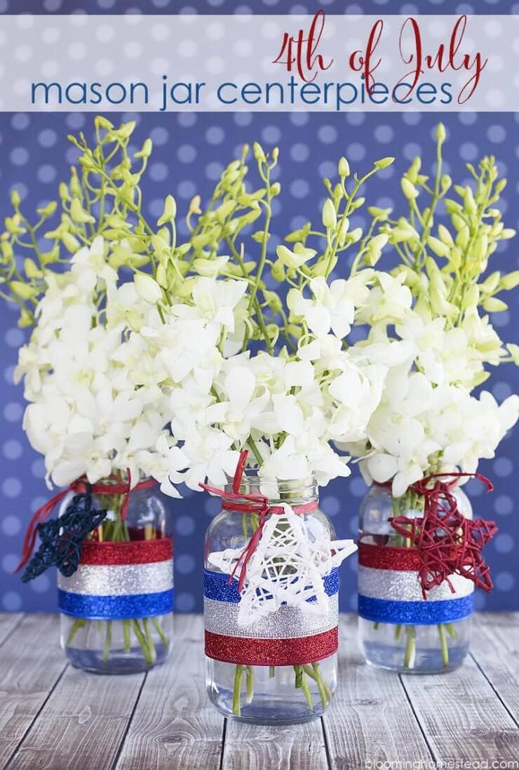 Patriotic Mason Jar Centerpiece http://www.bloominghomestead.com/wp-content/uploads/2016/06/4th-of-July-Mason-Jar-Decor.jpg