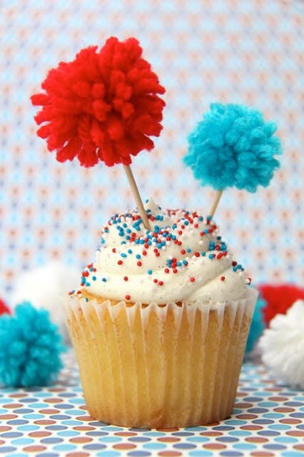 Pom Pom Firecracker Cupcake Toppers + 50 Festive Memorial Day BBQ Ideas...creative ways to kick-off summer and celebrate our freedom while remembering our fallen heroes!