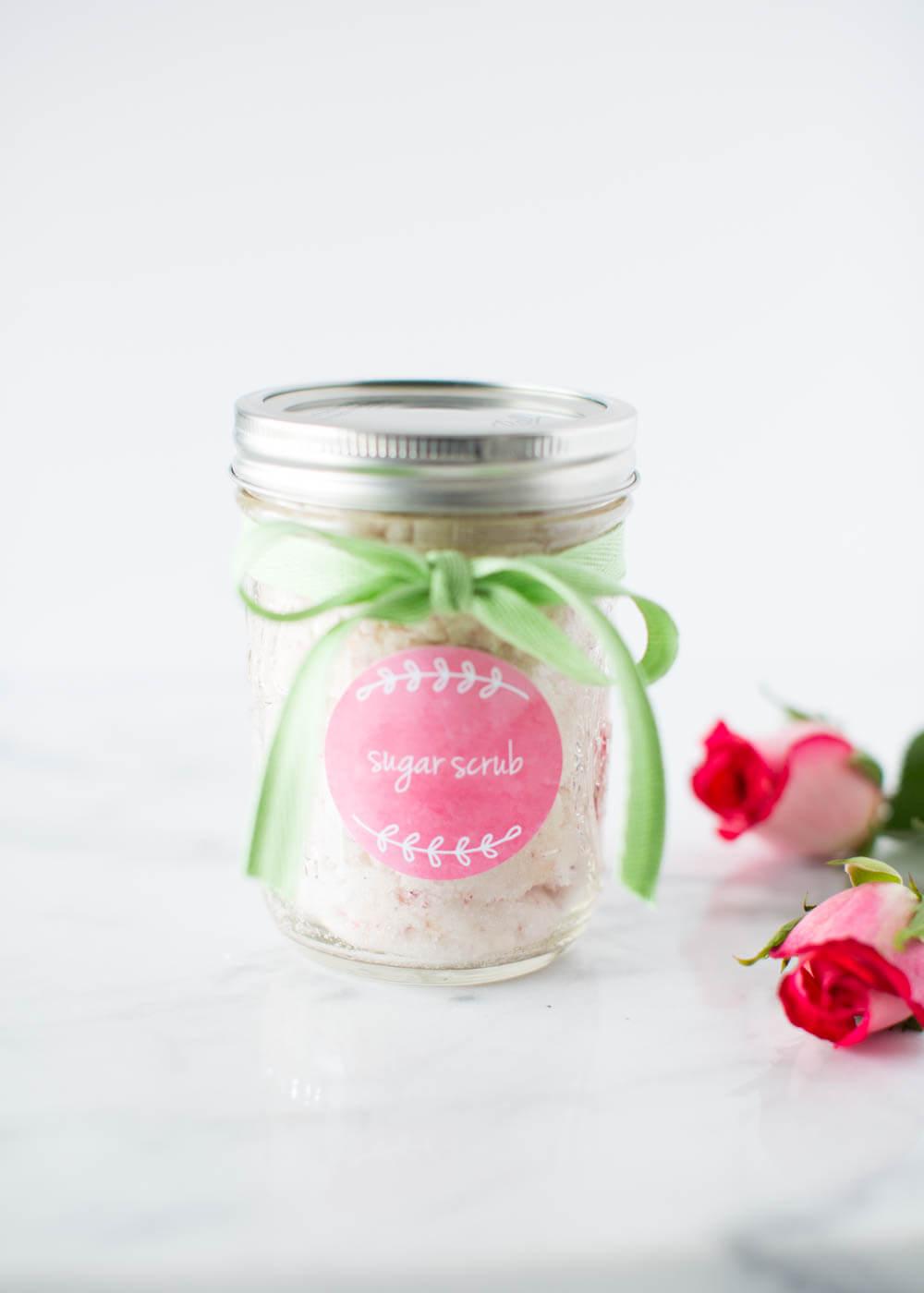 Vanilla sugar scrub in a mason jar with green ribbon