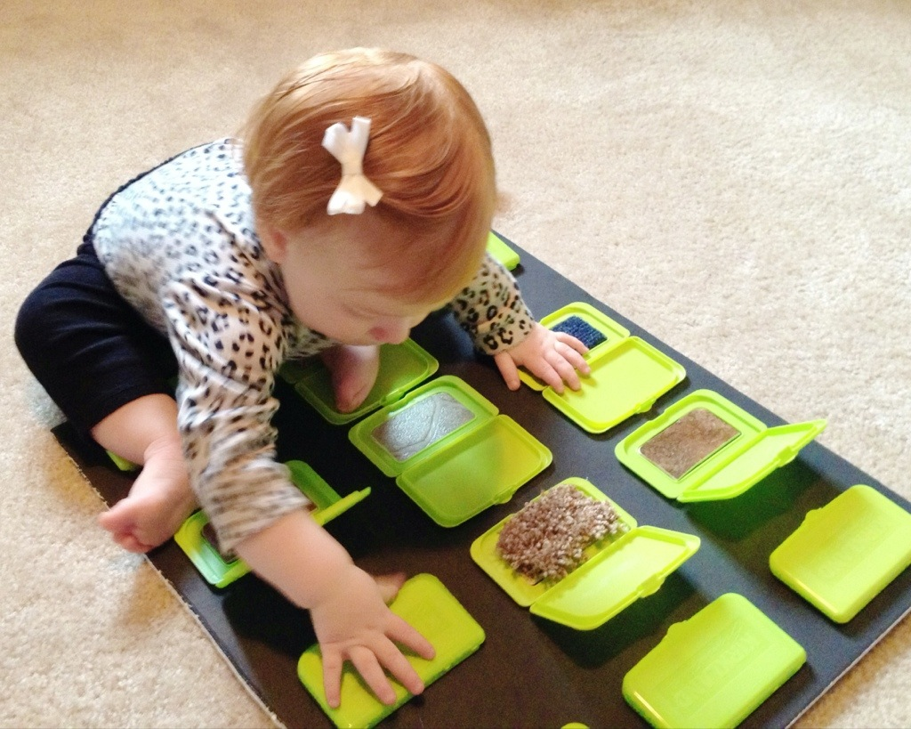 Sensory game with wipe container lids
